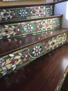 Yes, these are glass that are inlaid with the wooden stairs. Sure it's beautiful. But I don't think it would look right if you try it at home.