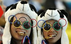 Because the panda bear hats make it incredibly obvious. Not sure about the medals in their mouths.