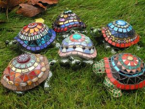 Yes, these are lawn turtles with mosaic shells. And yes, each is a unique work of art in its own way.