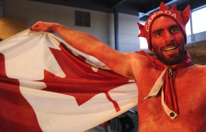 Yes, this guy painted himself to support his Team Canada. And he wears a maple leaf hat to boot.