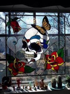This seems like a Southwestern or Mexican stained glass panel. Possibly for Dia de la Muertos.