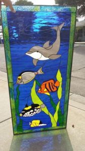 I think the fish should be wary of the dolphin. But this is a beautiful work of art. Love the blue sea.