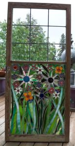 This one uses glass pieces inside an old window frame. And I'm sure you'll be in awe of these glass flowers.
