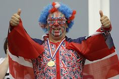 Because this British guy seems to look like a UK flag waving circus clown. Even has the wig and the face makeup.