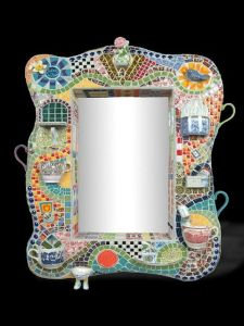 Yes, mosaic picture frames do exist. However, I especially like the little cups on this one. So clever.