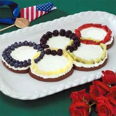 Each Olympic ring on this toast is of a fruit or veggie. And it's all on top of cream cheese.