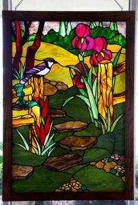 Seems like the blue jay is only a small part of this panel. But the flowers are pretty.