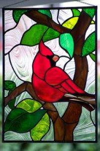 Like ocean life, birds are another popular stained glass motif. The northern cardinal and other backyard birds especially.