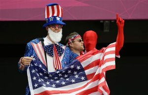 With one of them dressed as Uncle Sam. And at least two of them holding the flag, no doubt.