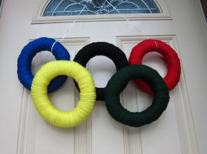 This is a yarn Olympic wreath. Each ring is wrapped in a different color. And they're all held up by a single string.
