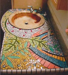 Then again, ceramic tiles tend to be in most bathrooms. Yet, this mosaic counter is probably not cheap in the least.