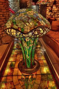 Yes, that's a stained glass lamp all right. And on a stained glass table, too. Not sure if it's a Tiffany though.