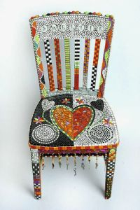 Yes, it's another mosaic chair. But this is in a very different style than the last one. And it has a few hearts to it.
