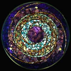 Of course, a lot of mosaics use geometric designs like the stained glass windows. But I like this one especially due to the purple center.