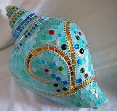 This one is covered in ceramic tiles and beads. At any rate, it must be either a large shell or one that has very small pieces.