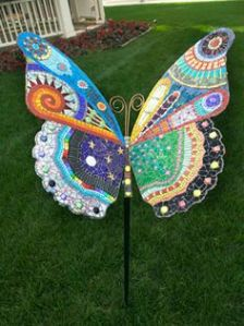 This one has quite a few designs on its wings. Not to mention, it's meant to be put on display in a lawn.
