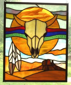 This depicts a longhorn with Indian feathers on a desert scene. You can't get more Southwest than that.