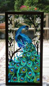 Yes, this is my second peacock stained glass panel. But this one has a more vivid tail. Love the feathers.
