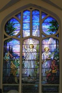 This one depicts angels appearing to the shepherds and announcing the birth of Christ. It's in Luke's Gospel. But I don't think this window was used for a church.
