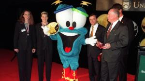 "From Buzzfeed: ""The 1996 Atlanta Summer Olympics brought us Izzy, short for ""What is he?"" Despite this clever wordplay, he was much-maligned, partly due to his resemblance to a ""Sperm in Sneakers."" Incidentally, he was the first computer-generated Olympic mascot. Overall, he looks disturbing-yet-harmless. Points for the fashion-forward color scheme and the use of the five Olympic rings on his butt and eyeballs, but otherwise, ""yikes"" at the very least."""