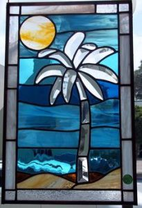 Beach scenes are fairly common stained glass motifs for some reason. Not sure why.