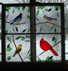 Consists of a Northern Bluebird, a Chickadee, a Goldfinch, and a Northern Cardinal. All these are North American birds.