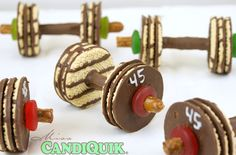 Made with chocolate pretzel sticks, shortbread cookies, and lifesavers. Easier to make than lifting big weights in the weightlifting competition.