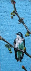 This bird almost looks like one you'd see from your window. But it's in ceramic tile.