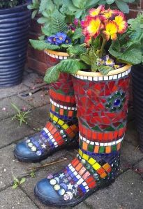 Yet, they also have lovely mosaic decoration on them. Also like the flowers in them. Yes, these are boot planters.