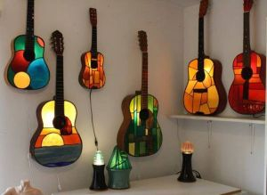 I don't think these guitars are for playing since they light up and are made of glass. But I couldn't pass these up.