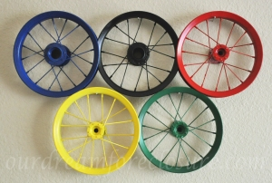They're probably bike wheels without tires. But each is painted a different color and hung to a wall.