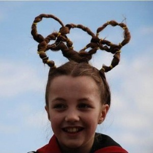 Yes, she has her hair in Olympic rings. Perhaps it's not the craziest display at the Olympics. But it's up there.