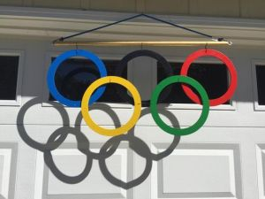 Not sure if the rings are made from metal. Not sure if I'd want this hanging over a garage either. Yet, it casts a nice shadow.