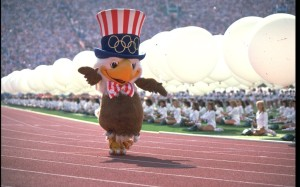 "From SBNation: ""This halter-top-wearing, pantsless glad-hander was designed by the Walt Disney Company, because of course he was. Can you imagine us hosting the Olympics in the 1980s and NOT showing up with a Walt Disney-designed mascot? We'd be the laughingstock of the world! I don't have any idea what Sam's voice sounded like, but I'm guessing it was somewhere between Colonel Sanders and Paul Newman. You know who should have voiced this character, though? Richard Simmons. Take a look at Sam. Now imagine him talking in Richard Simmons' voice. You're welcome."""