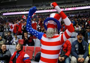 Here he is in an American flag suit as well as his hat, glasses, and beard. And he's really getting into it.