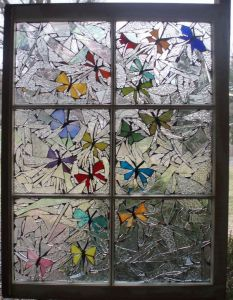Sure it's a stained glass mosaic. But I said the two tend to go together. Also, you have to admire the butterflies on this.