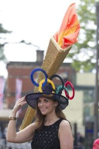 Now that's a really big hat with a really big torch. Not sure if I'd want to sit near someone like her.