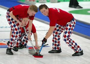 Seems like the Norwegian men's curling team doesn't disappoint. Apparently, they prefer table cloth pants that year.