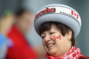 Because she's wearing a curling stone hat. Helps that she's also from Canada, eh.