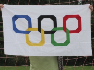 I guess this is another Olympic quilt design. Like how it has a unique spin on the rings. Don't see anything like that every day.