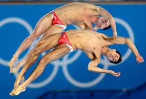 Bronze medalists Nicholas McCrory, front and David Boudia, rear, from the US compete during the Men's Synchronized 10 Meter Platform Diving final at the Aquatics Centre in the Olympic Park during the 2012 Summer Olympics in London, Monday, July 30, 2012. (AP Photo/Michael Sohn)