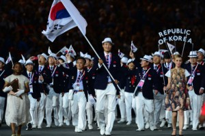 Had they waited until 2016 to wear these, they would've been appropriately dressed. But no, South Korea isn't known for their Panama hats.