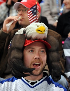 Well, he has an American Eagle on his hat. That and not supporting Donald Trump.