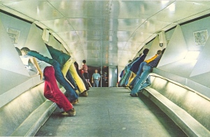 """Caption: """"A roomy observation platform at the top of the Gateway Arch offers 32 windows for viewing a thirty mile panorama of Missouri and Illinois."""" However, why they decided to take the rear view of the tourists, I have no idea."""