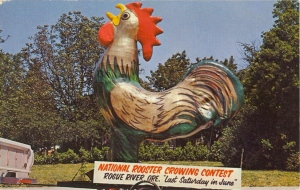 Marked by an enormous rooster statue. Has a plumage of green and gold unlike most roosters. Perhaps it symbolizes Rogue River's profits.