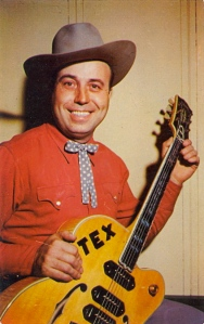 "From Bad Postcards: ""Tex, if you'd like to break into a larger market, start by emblazoning your name on your instrument with something other than electrical tape."" Yeah, that kind of looks very cheap."