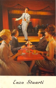 "From Bad Postcards: ""The guys at the table seem more enamored of Enzo than the women. Where's the band?"" When you think about it, it seems about right."