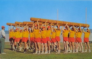 Actually this is a bunch of marines at Parris Island doing a log lifting exercise. And all in unflattering fitness attire.