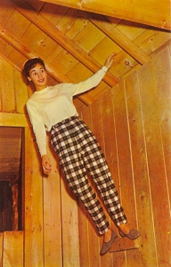 I doubt that she's managed to defy gravity. However, her checkered pants seem to defy fashion.