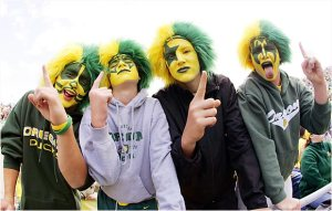 They even have the Kiss faces with green and yellow makeup. And they're wearing matching wigs, too.
